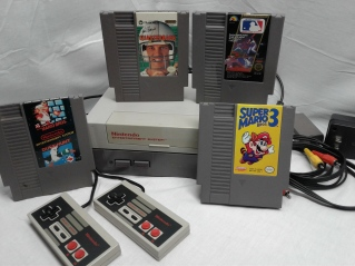 Original NES Game System with refurbished 72 Pin Connector, 2 controllers, and 4 games. All games cleaned, tested, and working.